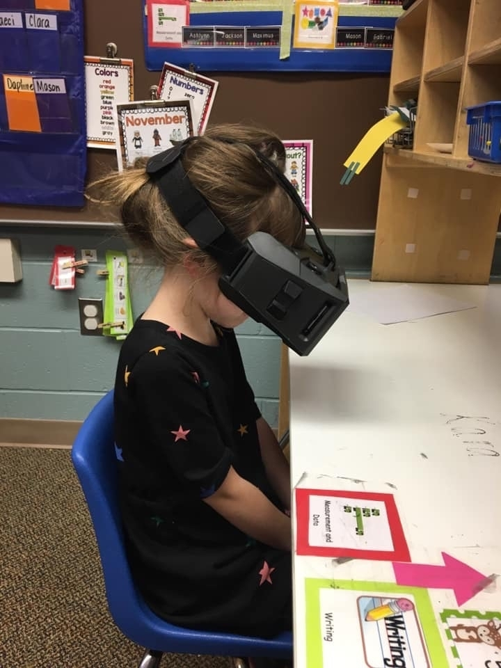 Kid with VR headset on.