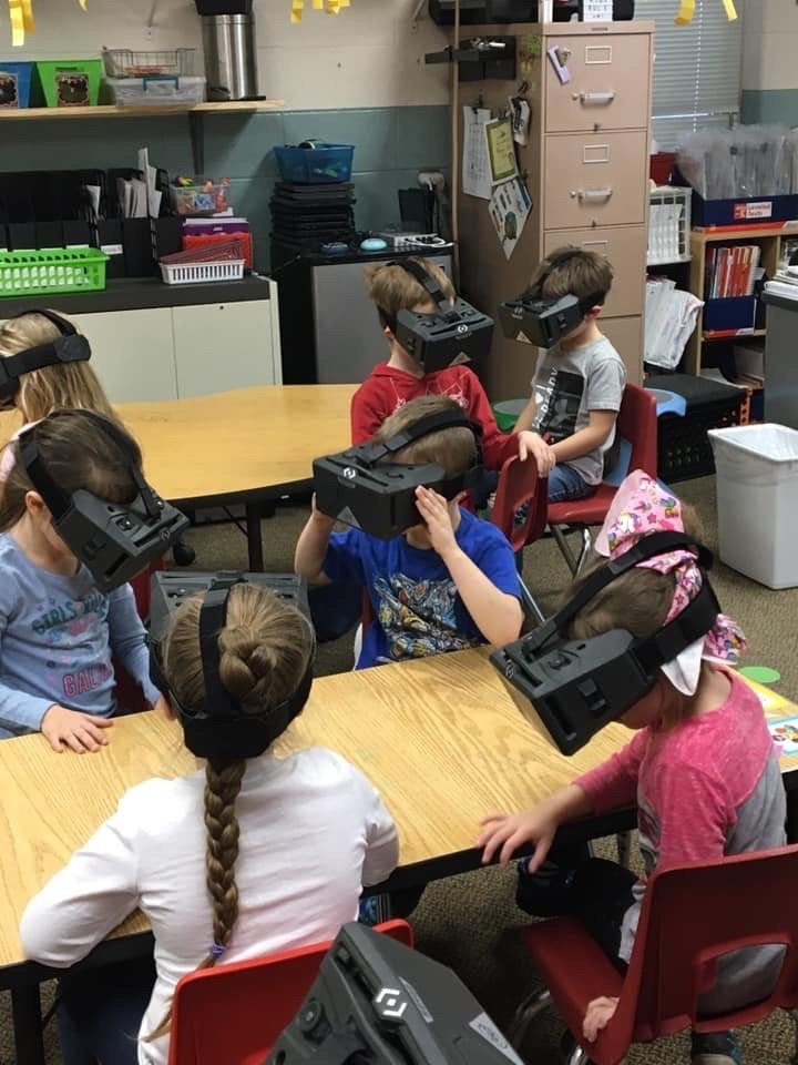Kids with VR headsets on.