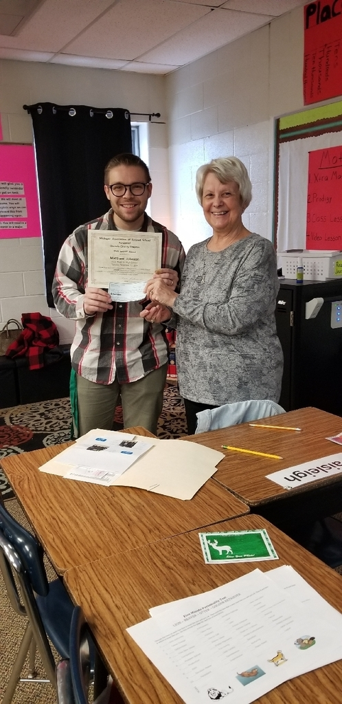 6th grade teacher Matt Johnson receiving his grant from Mrs. Wilson!